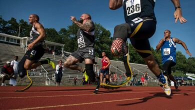 Staff Sgt. Rey Edenfield (far right), an Air Force wounded warrior athlete, sprints toward the finish line with fellow competitors at the 2015 Department Of Defense Warrior Games