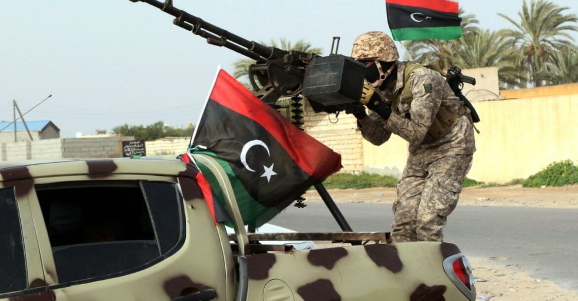 Libyan soldier standing on top of a car