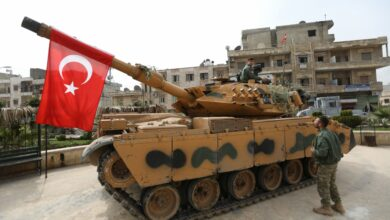 A tank belonging to Turkish soldiers and rebel Free Syrian Army fighters is seen in the Kurdish-majority city of Afrin, in northwestern Syria, after they took control of the city from the Kurdish People's Protection Units (YPG), on March 18, 2018