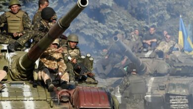 Ukrainian army soldiers ride a tank