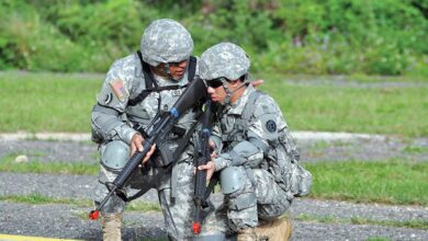A US Army Master Sergeant provides guidance to a Pvt. during a field training exercise.