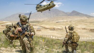Soldiers from 1st Battalion, 121st Infantry Regiment of the 48th Infantry Brigade Combat Team provide security as a CH-47 Chinook helicopter lands after a key leader engagement in Southeastern Afghanistan